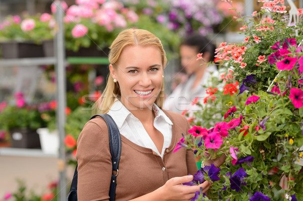 Smiling customer with colorful flowers garden center Stock photo © CandyboxPhoto