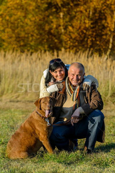 Cheerful couple with dog in autumn park Stock photo © CandyboxPhoto