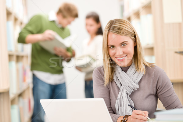 High school library - happy student with laptop  Stock photo © CandyboxPhoto