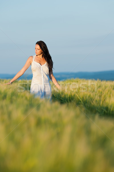 Sunset corn field beautiful brunette woman walk Stock photo © CandyboxPhoto