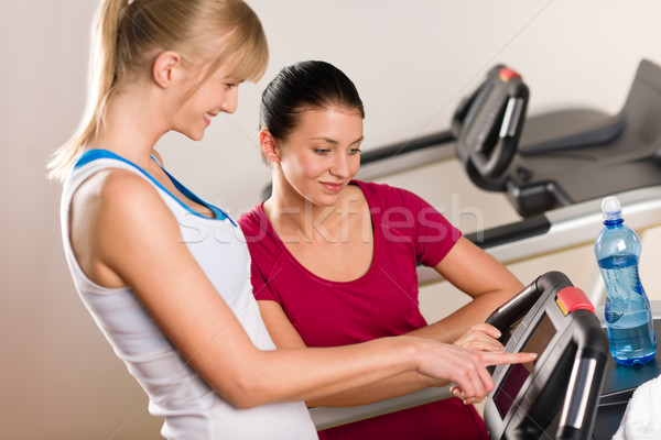 Young female friends chatting in fitness center Stock photo © CandyboxPhoto
