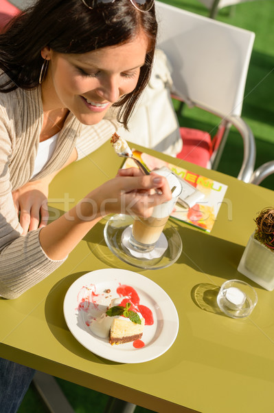 Woman eating cheesecake at cafe bar happy Stock photo © CandyboxPhoto
