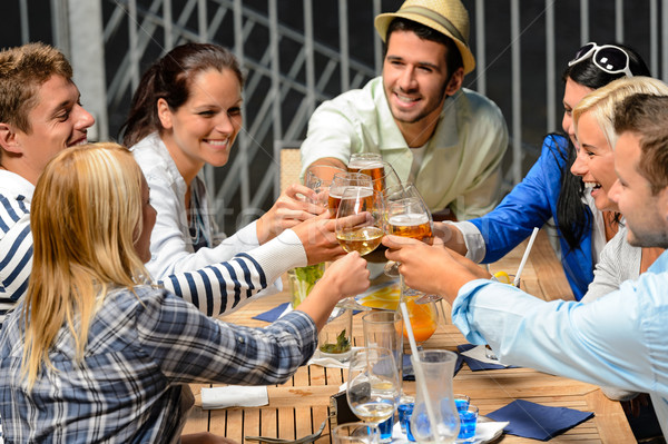 Group of cheerful people toasting with drinks Stock photo © CandyboxPhoto