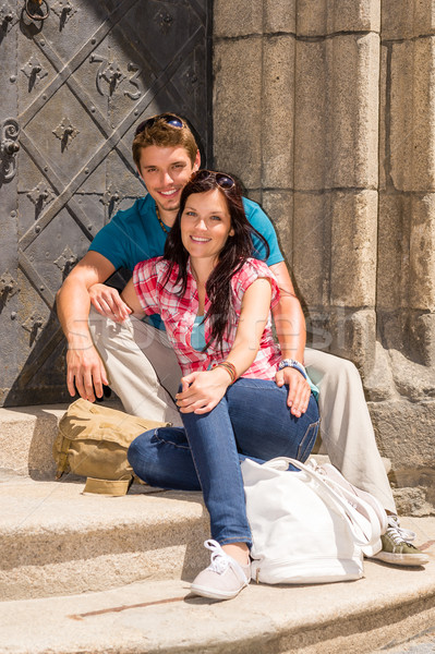 Young couple sitting on building steps smiling Stock photo © CandyboxPhoto