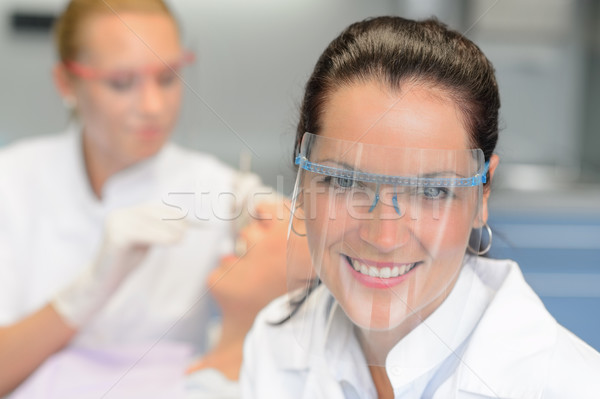 Professional dentist protective glasses patient checkup Stock photo © CandyboxPhoto