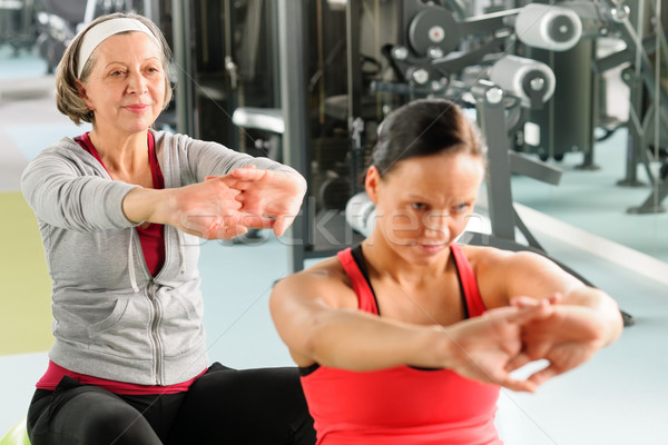 Two women at gym stretch out Stock photo © CandyboxPhoto