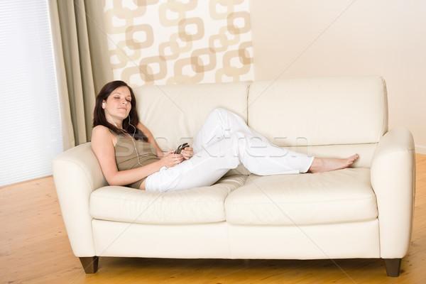 Kadın müzik Çalar dinleme kanepe ev Stok fotoğraf © CandyboxPhoto