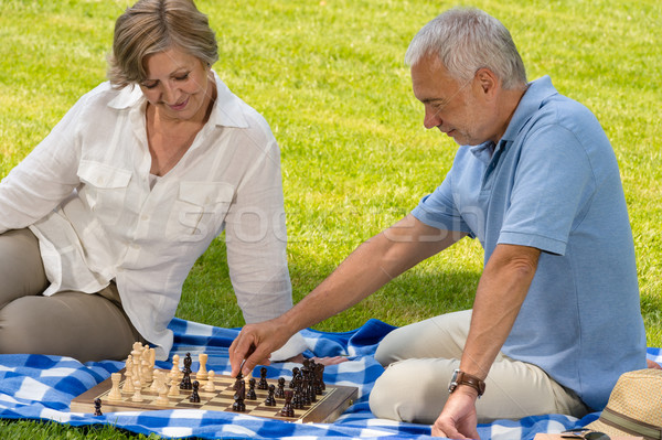 Retired senior couple playing chess in park Stock photo © CandyboxPhoto