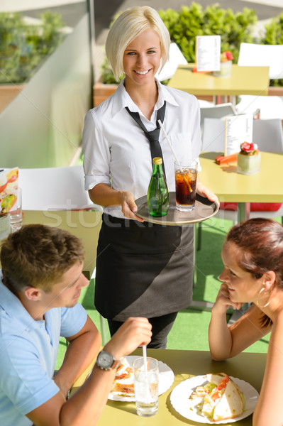 Waitress bringing beverages on tray to couple  Stock photo © CandyboxPhoto