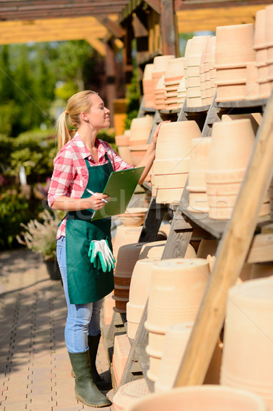 Garden center woman check clay pots Stock photo © CandyboxPhoto