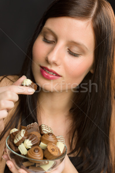 Chocolate - portrait young healthy woman eat candy Stock photo © CandyboxPhoto