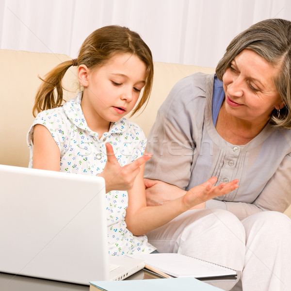 Grandmother and young girl with laptop learn count Stock photo © CandyboxPhoto