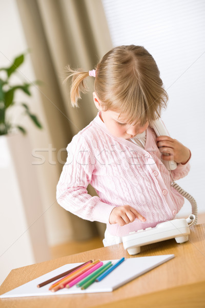Little girl dial number on phone in lounge Stock photo © CandyboxPhoto