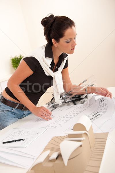 Attractive female architect watching plans  Stock photo © CandyboxPhoto