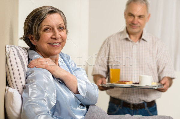 Caring senior man bringing breakfast to wife Stock photo © CandyboxPhoto