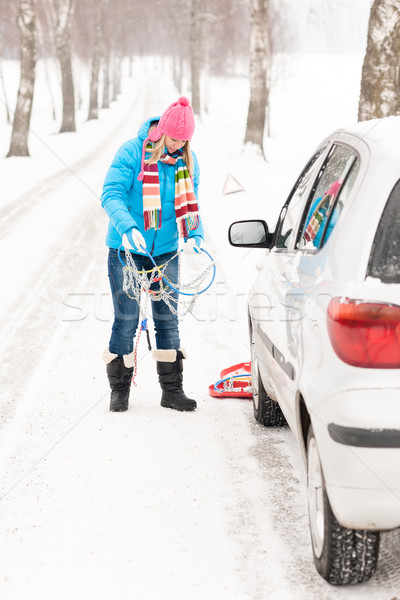 Woman snow standing with car tire chains Stock photo © CandyboxPhoto