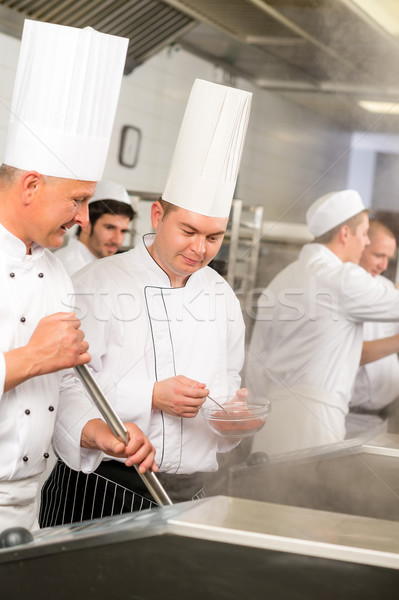 Two male cook work in professional kitchen Stock photo © CandyboxPhoto