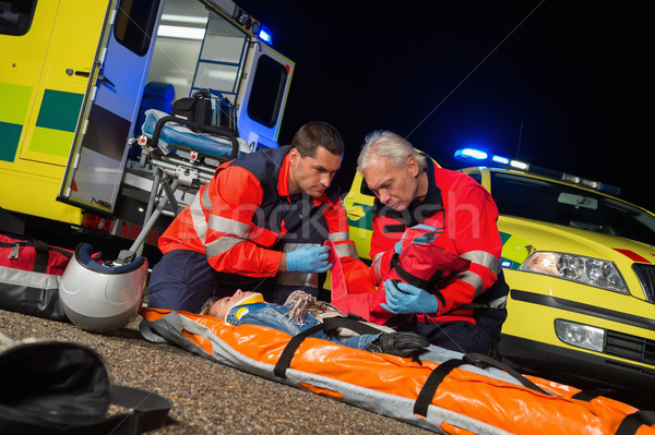 Paramedics giving firstaid to motorbike driver Stock photo © CandyboxPhoto