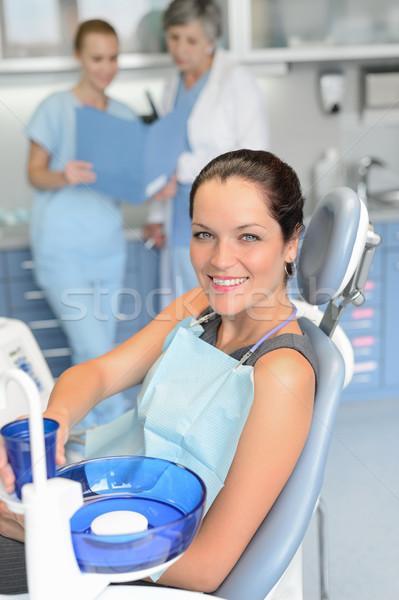 Mulher paciente sessão cadeira cirurgia dentária profissional Foto stock © CandyboxPhoto