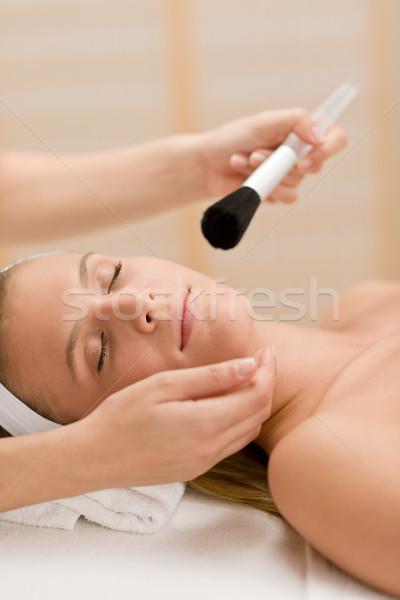 Stock photo: Facial care - woman in salon apply powder