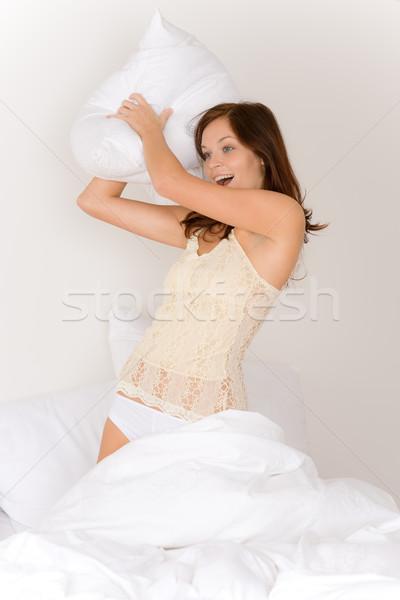 Yastık kavgası genç kadın yatak ışık ev Stok fotoğraf © CandyboxPhoto