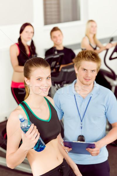 Zdjęcia stock: Młodych · kobieta · fitness · instruktor · rower · siłowni · sportu