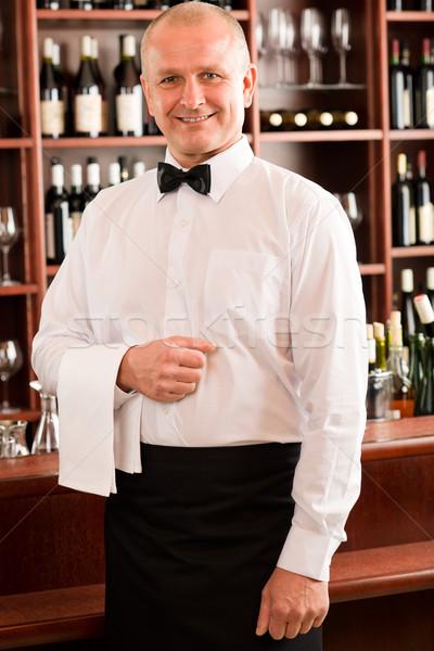 Wine bar waiter mature smiling in restaurant Stock photo © CandyboxPhoto