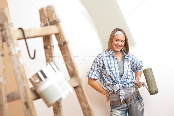Home improvement: Young woman with paint roller and ladder  Stock photo © CandyboxPhoto