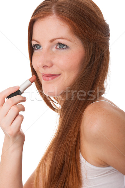 Body care series - Beautiful young woman applying lipstick Stock photo © CandyboxPhoto