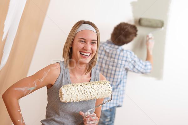 Lakásfelújítás fiatal pér festmény fal festék ház Stock fotó © CandyboxPhoto