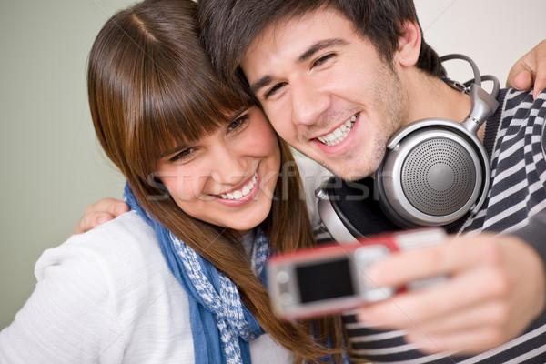 Students - happy teenage couple taking photo with camera Stock photo © CandyboxPhoto