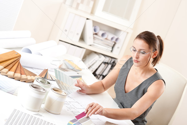 Stock photo: Female interior designer working with color swatch