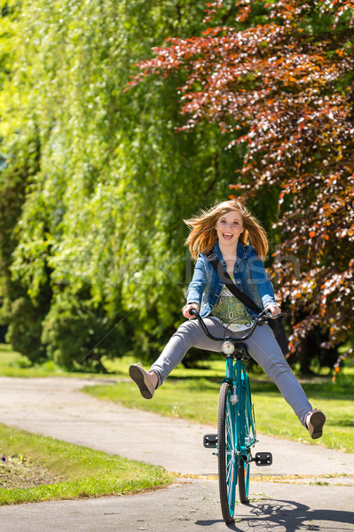 Carefree teenager riding bicycle across the park Stock photo © CandyboxPhoto