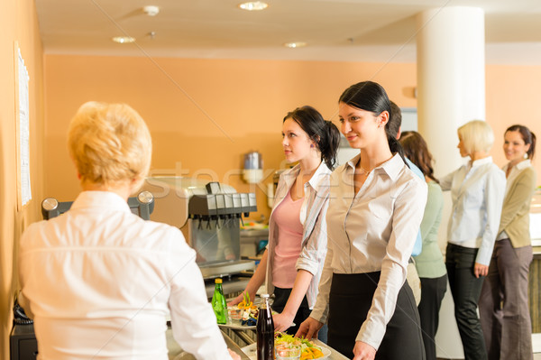 Cafeteria pay at cashier women in queue Stock photo © CandyboxPhoto