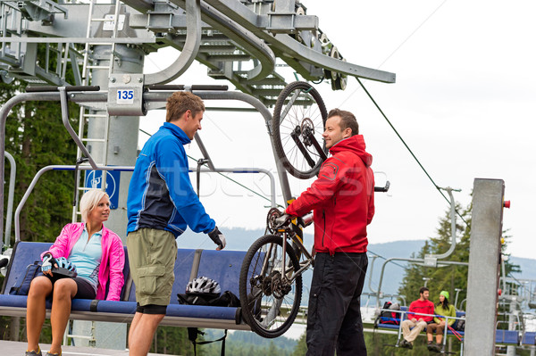 Man helping couple holding bicycle chair lift Stock photo © CandyboxPhoto