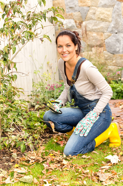 Smiling woman gardening yard fall hobby housework Stock photo © CandyboxPhoto
