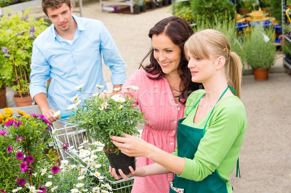 Garden center florist selling flowers to couple Stock photo © CandyboxPhoto