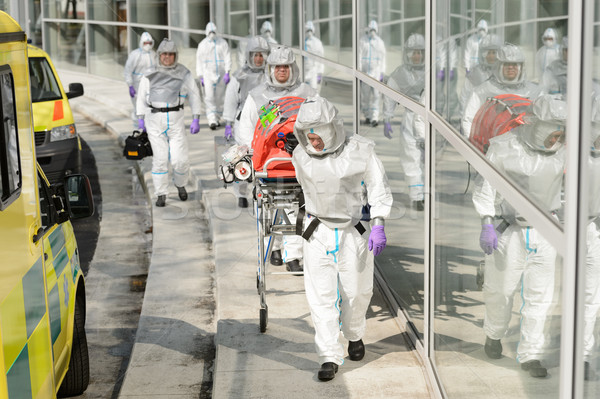 Biohazard medical team walking to building Stock photo © CandyboxPhoto
