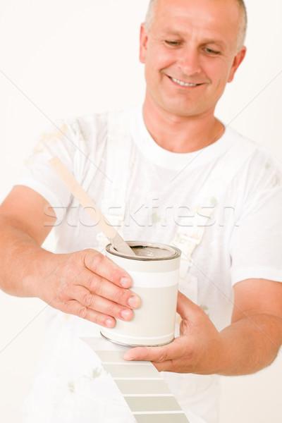 Stock photo: Home decorating mature male painter mix color