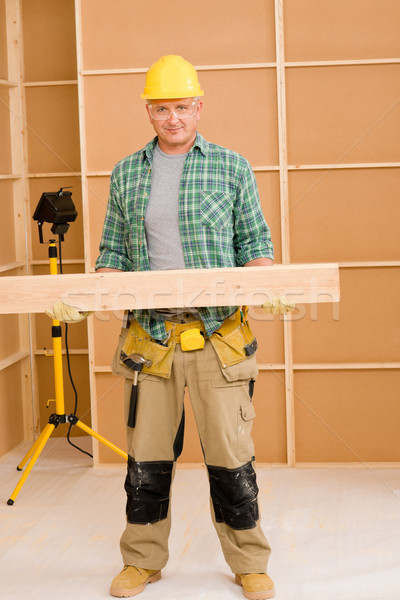 Stock photo: Handyman carpenter mature carry wooden beam