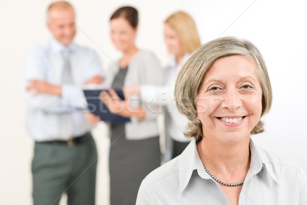 Сток-фото: бизнес-команды · старший · женщину · счастливым · коллеги