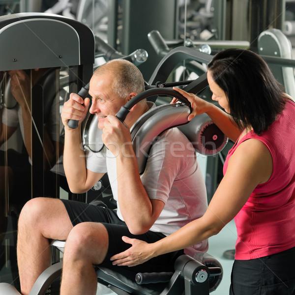 érett férfi testmozgás személyi edző tornaterem felügyelet sport Stock fotó © CandyboxPhoto