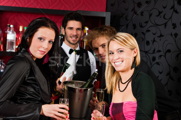 Happy girl friends drink champagne Stock photo © CandyboxPhoto