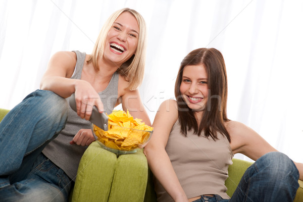Student series - Two young woman watching TV Stock photo © CandyboxPhoto