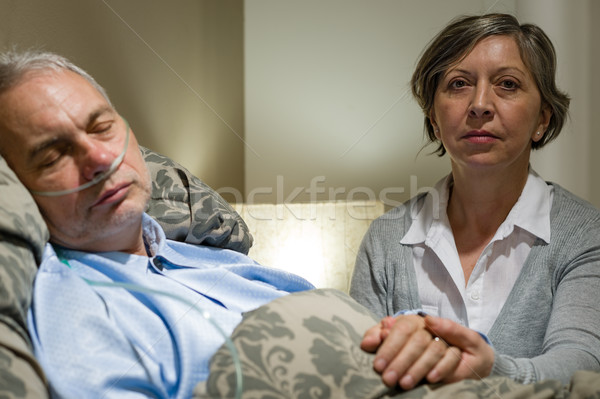 Caring wife holding sick senior husband's hands Stock photo © CandyboxPhoto