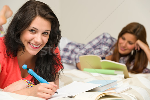 Smiling female students preparing for exam Stock photo © CandyboxPhoto