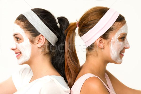 Girls sitting back-to-back wearing facial mask Stock photo © CandyboxPhoto