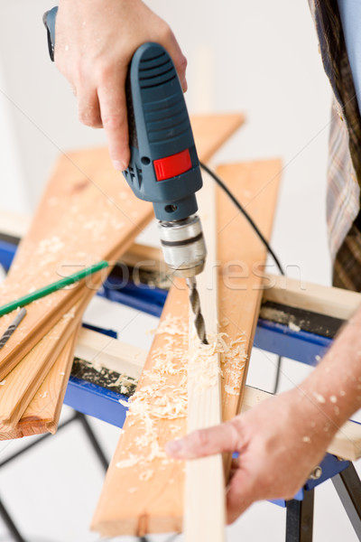 Stock photo: Home improvement - handyman drilling wood