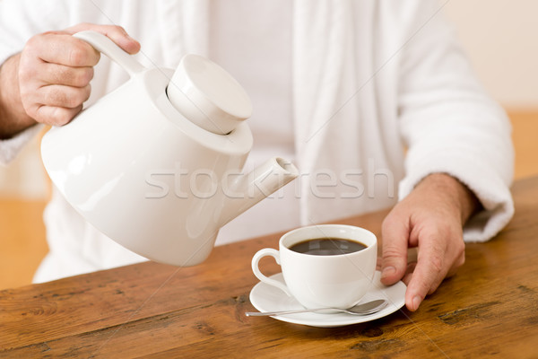 Senior mature man pour coffee wear bathrobe Stock photo © CandyboxPhoto