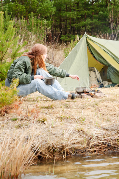 Camping woman tent cook food fire nature Stock photo © CandyboxPhoto